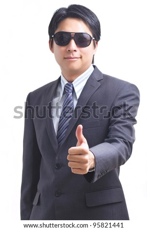 Asian business man giving thumb up, isolated on white - stock photo