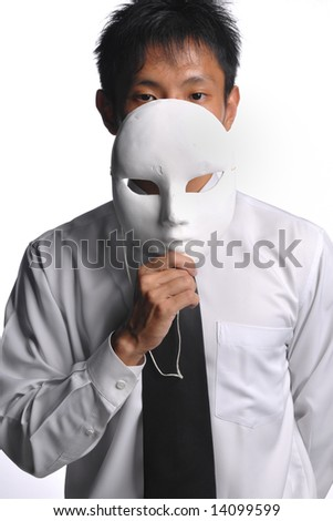 asian business man hiding behind mask - strategy - stock photo