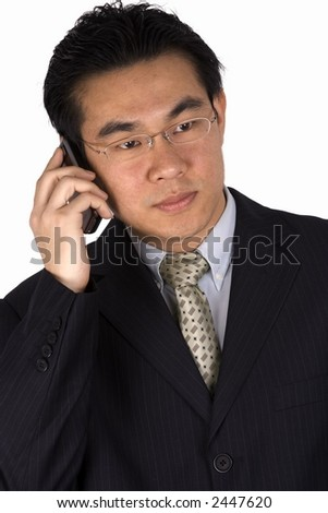Asian business man holding a mobile phone. - stock photo