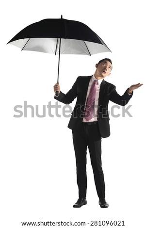 Asian business man holding black umbrella isolated over white background - stock photo