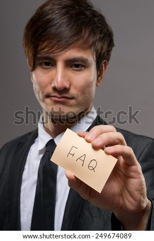 Asian business man holding card writing words, closeup portrait focus on card. - stock photo
