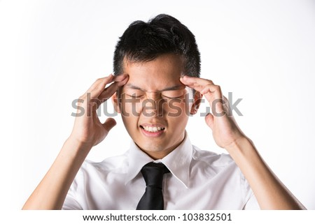 Asian business man holding his head. Conceptual image. - stock photo