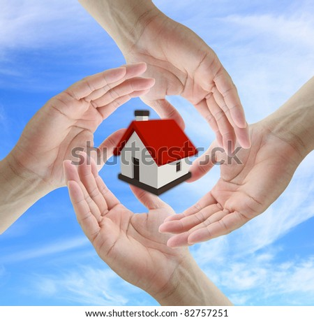 Asian business man holding house for insurance concept - stock photo