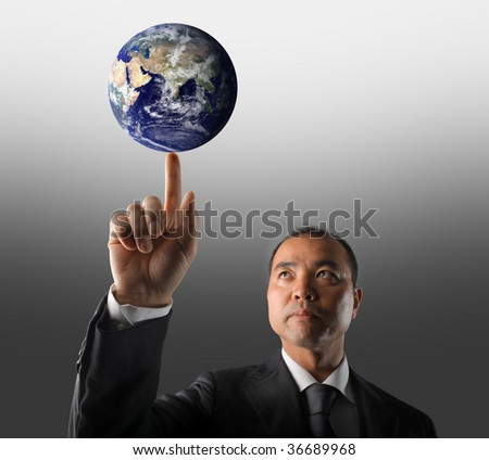 asian business man holding planet earth - stock photo