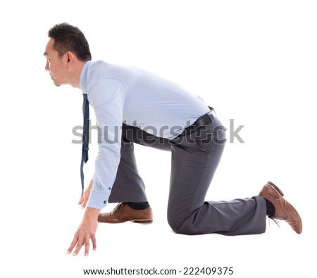 Asian business man on starting line of a race, side view full length isolated over white background. - stock photo