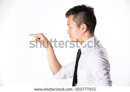 Asian business man pointing his hand to left. Room left for your message. - stock photo