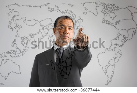 asian business man pointing Japan on a map - stock photo
