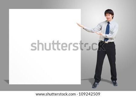 Asian business man showing blank signboard - stock photo