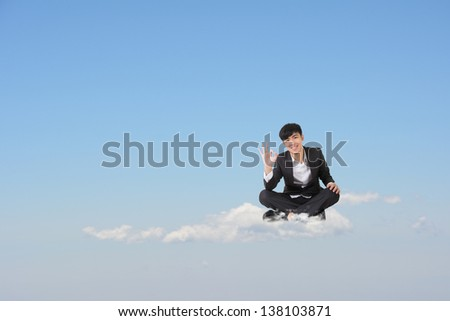 Asian business man sit on cloud over sky and give you an ok gesture, cloud concept for business, creative, technology, social network etc.