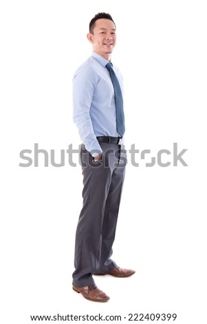 Asian business man smiling, full length standing isolated over white background. - stock photo