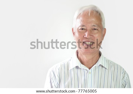 asian business man smiling in formal clothing with plain background