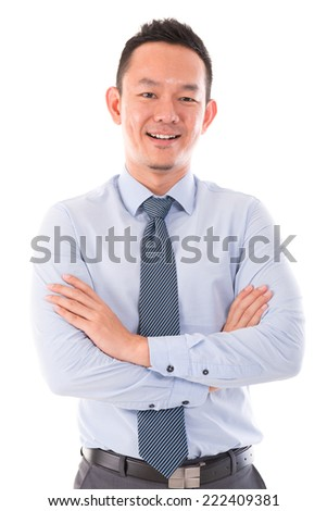 Asian business man smiling, standing isolated over white background. - stock photo