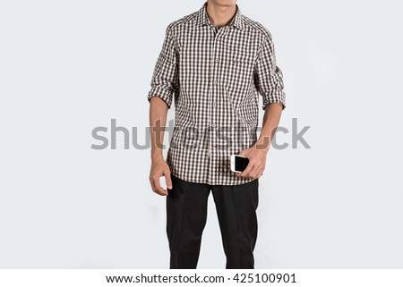 Asian business man standing and holding mobile smart phone. - stock photo
