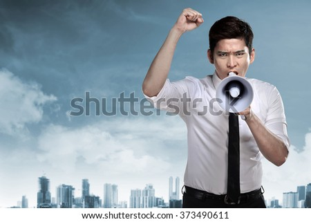 Asian business man talk loud using megaphone - stock photo
