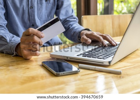 Asian business man using laptop for online shopping.Vintage tone,Retro filter effect,Soft focus,Low light.(selective focus)  - stock photo