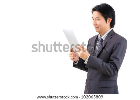 Asian business man using tablet computer isolated on white background - stock photo