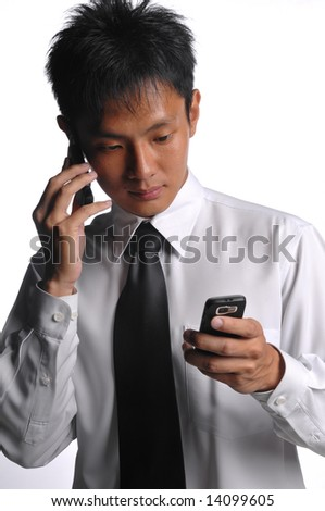 asian business man using two phones - stock photo