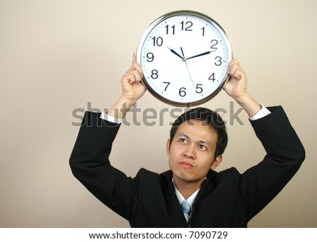 Asian business man with clock (series) - stock photo