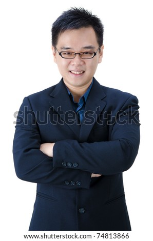 asian business man with hands crossed - stock photo