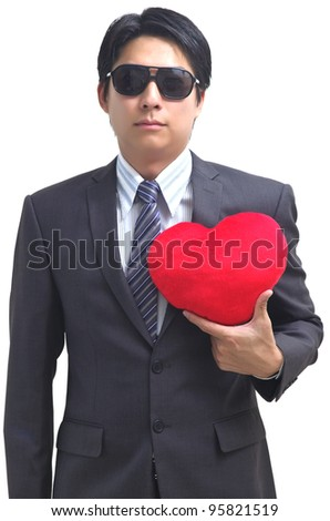 Asian business man with red heart isolated on white - stock photo
