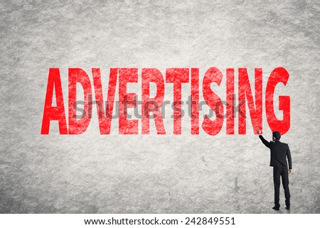 Asian business man write words on wall, Advertising - stock photo