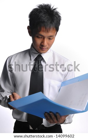 asian business manager looking through documents - stock photo