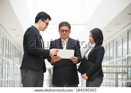 asian business meeting with ceo using tablet