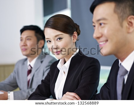 asian business people at a meeting. - stock photo