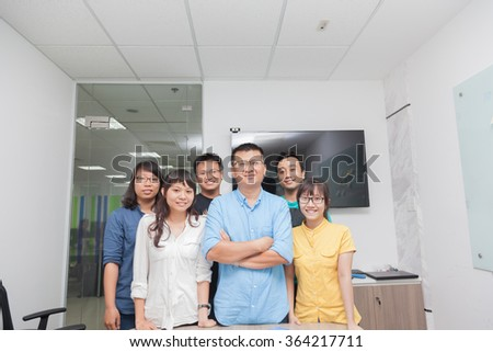 Asian business people group team leader boss real office - stock photo