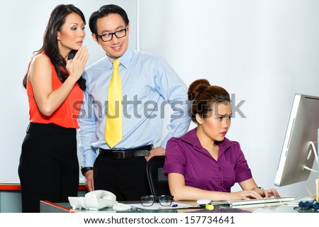 Asian Business people in office gossiping about each other or mobbing - stock photo