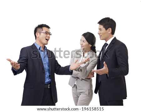 asian business people talking, isolated on white.