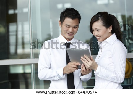 Asian  Business people using a Digital Tablet