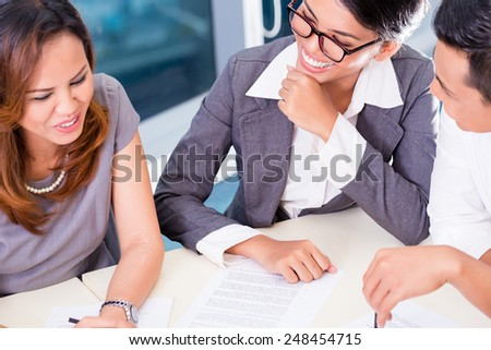 Asian business team brainstorming in project meeting - stock photo