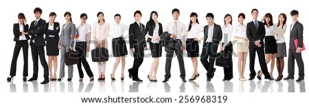 Asian business team, businesswoman and businessman in group standing and looking at you, isolated on white background.