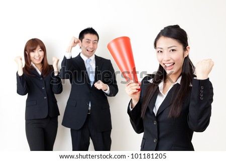 asian business team cheering isolated on white background - stock photo