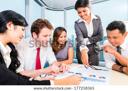 Asian business team in brainstorming planning new project and discussing ideas - stock photo
