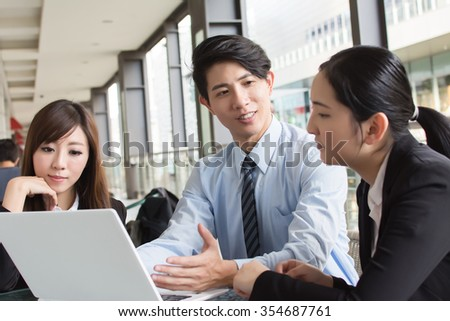 Asian business team in the city. - stock photo