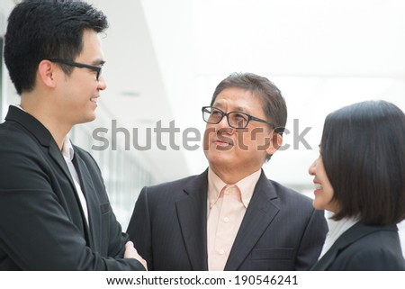 Asian business team meeting. Group of businesspeople having discussion over office. CEO and staffs. - stock photo