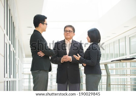 asian business team meeting over their office