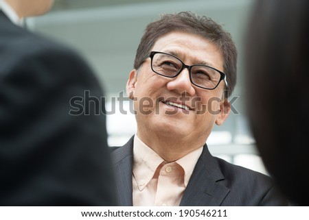 Asian business team meeting. Senior male businessman. CEO having discussion with business executive.   - stock photo