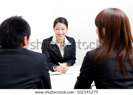 asian business team working on the office - stock photo