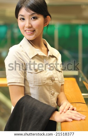 asian business woman at airport - stock photo