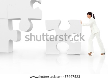 Asian business woman building a puzzle - isolated over a white background