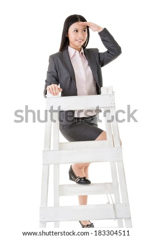 Asian business woman climb a ladder, full length portrait isolated on white background. - stock photo