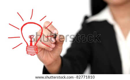 Asian business woman drawing light bulb for creativity concept - stock photo