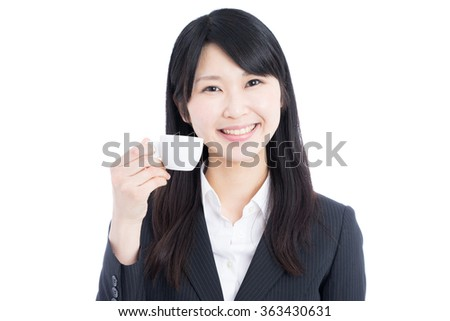 Asian business woman drinking espresso coffee isolated on white background - stock photo