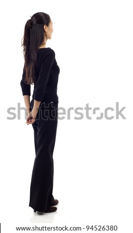 Asian business woman from the back - looking at something isolated over white background - stock photo