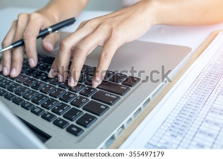 Asian business woman hands typing on laptop computer.Vintage tone,Retro filter effect,Soft focus,Low light.(selective focus)