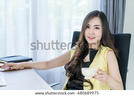 asian business woman happy with coffee cup in office
