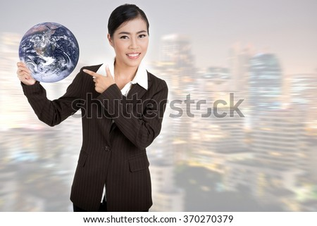 Asian business woman hold globe.Elements of this image furnished by NASA - stock photo